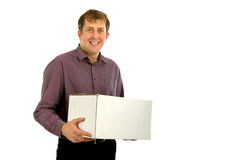 The young man holds a white box , portrait. The young man holds a white box on is isolated a background Stock Photos