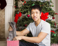 Young Man with Holiday Gifts Royalty Free Stock Photography