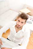 Young man at home with a laptop Royalty Free Stock Image