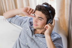 Young man at home relaxing on the sofa Royalty Free Stock Photography