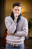 Young man at home sick, coughing Stock Photography