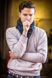 Young man at home sick, coughing Royalty Free Stock Photo