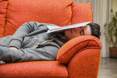 Young man at home sleeping instead of working or Royalty Free Stock Photos