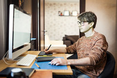 Young man at home using a computer Stock Photos
