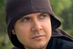Young man with hood. Portrait of young man with hooded top; green background Stock Photos