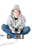 Young man in hood with a joystick. For game console Stock Photography