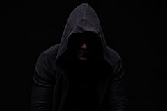 Young man in hood and shadow Stock Photos