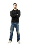 Young man in hoodie with crossed arms looking at camera Royalty Free Stock Photos