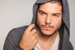 Young man with hoodie on looking to side Royalty Free Stock Photo