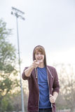 Young man in a hoodie pointing his finger Stock Image