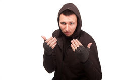Young man in a hoodie standing in a fighting stance Stock Photo