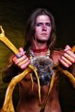 A young man with a horn of deer in his hands.  Royalty Free Stock Photos