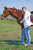 Young man and horse Royalty Free Stock Photography