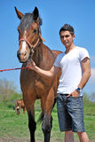 Young man and horse Stock Photography
