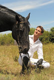 Young man and horse Royalty Free Stock Images