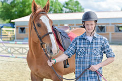 Young man with horse. Young man with a horse Royalty Free Stock Images