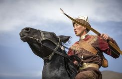 Young man on a horse with bow and arrows royalty free stock photo