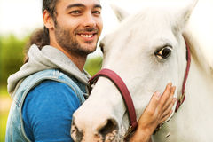 Young man with a horse Royalty Free Stock Image