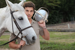 Young man with horse Royalty Free Stock Photo