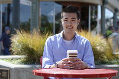 Young man with a hot drink Royalty Free Stock Photos