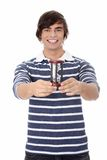 Young man with hourglass. Stock Image