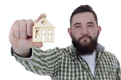 Young man with house model Royalty Free Stock Images
