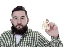 Young man with house model Stock Images