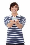 Young man with house's model. Stock Photography