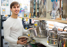 Young man in household store Stock Photos