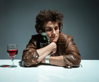 Young man is hugging a bottle of wine Royalty Free Stock Photo