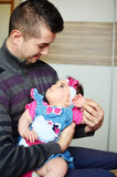 Young man hugging cute baby girl Stock Images