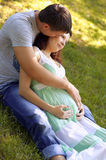 A young man hugging his pregnant happy wife Stock Images