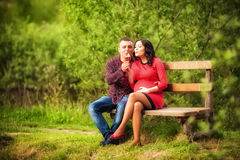 Young man hugging his pregnant happy wife Royalty Free Stock Photography
