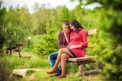 Young man hugging his pregnant happy wife Stock Photography