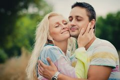 Young man hugging Royalty Free Stock Images