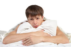 Young man hugging pillow Stock Photo