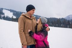 A young man hugs a girl and look at each other against a backdro Royalty Free Stock Image