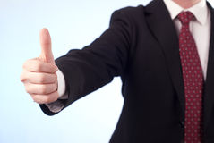 I like it sign. Young man i n black suit with thumbs up Royalty Free Stock Photos