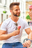 Young man with ice-cream Royalty Free Stock Images