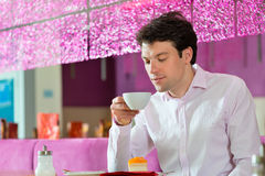 Young man in ice cream parlor Royalty Free Stock Photos