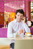 Young man in ice cream parlor Royalty Free Stock Photography