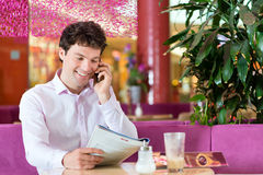 Young man in ice cream parlor Royalty Free Stock Photo