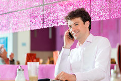 Young man in ice cream parlor Stock Images