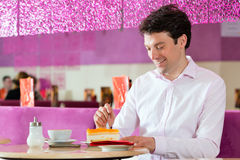 Young man in ice cream parlor Stock Photo