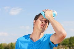 Young man with ice pack. In summer Stock Images
