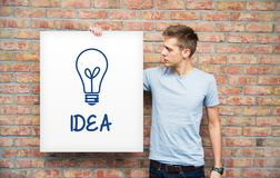 Young man with idea bulb Royalty Free Stock Image