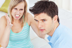 Young man ignoring his girlfriend Stock Photography