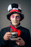 Crazy Hatter. Young man in the image of the Crazy Hatter from Alice's Adventures in Wonderland by Lewis Carroll royalty free stock photo