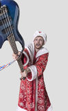 Young man in the image of Santa Claus with a guitar Stock Photography