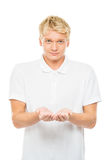 Young man with an imaginary object isolated on white Royalty Free Stock Image